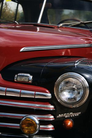 Old classic car detail if the front grill and bonnet Stock Photo