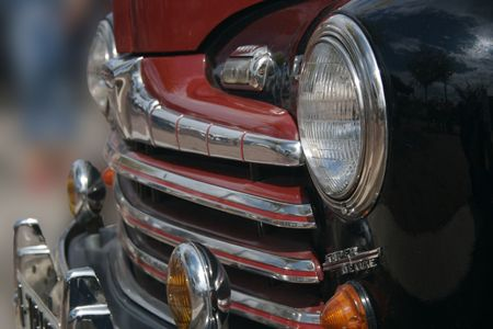 Old classic car detail if the front grill and lots of chrome