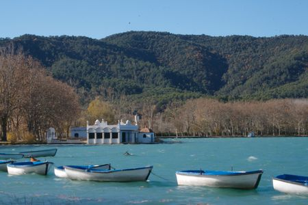 boats on the only lake in Catalonia, Spain - turquoise water Stock Photo