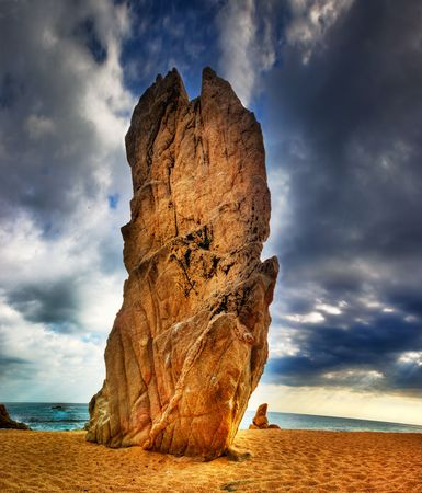 The rock symbol for the town of Platja dAro with a soft focus effect and enhanced colour and High dynamic range