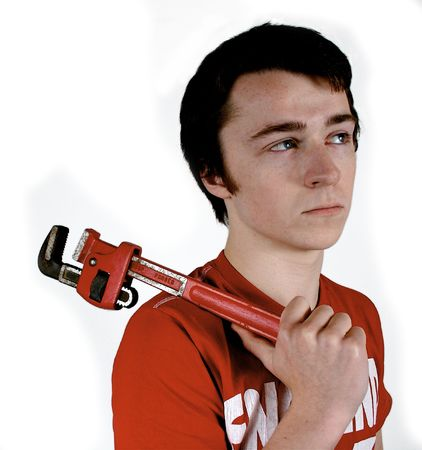 wage earner: Young worker holding a wrench thinking about the job to be done