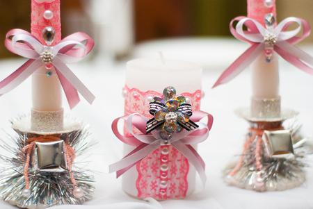 Wedding decor. wedding interior. festive decor. Pastel decor. Candles close up. The vague image. vintage candels, weeding decoration