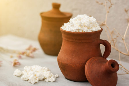 Organic Farming Cottage cheese in a crock Stock Photo