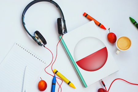 the book with polish flag and headphones. concept of Polish learning through audio courses Stock Photo
