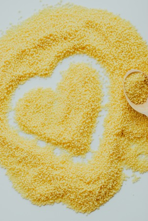 Raw cous cous background on white background Stock Photo
