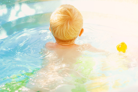 Portrait of baby boy enjoying swimming in pool