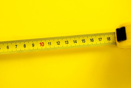 Yellow Measuring Tape on yellow background