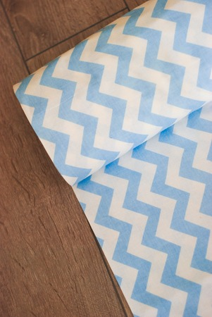 Cotton zigzag fabric on a wooden background