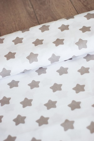The texture of cotton fabric. Fabric with a pattern of stars creates a textural background. Natural cotton fabric for sewing. Stock fotó