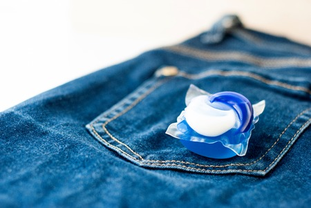 Washing detergent capsule pod on jeans.