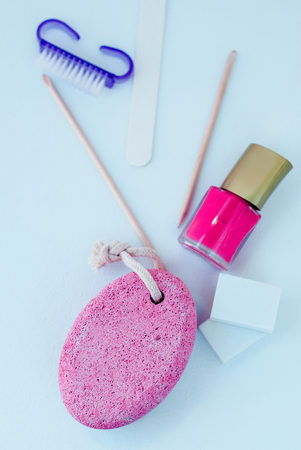 Feet care. Pedicure accessories with nail polish on white background