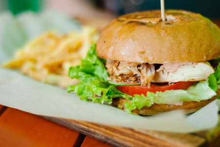 chicken burger with french fries on a wooden table 스톡 콘텐츠 - 127246969