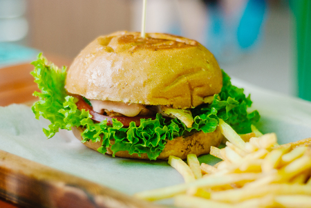 chicken burger with french fries on a wooden table 스톡 콘텐츠 - 127246985