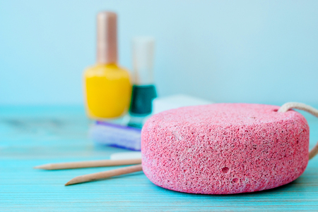 Pedicure accessories with nail polish on wooden background 스톡 콘텐츠 - 125606954