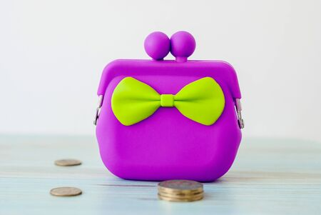 Purple cash wallet on wooden background. Charge purse. Empty coin wallet. 스톡 콘텐츠 - 125607038