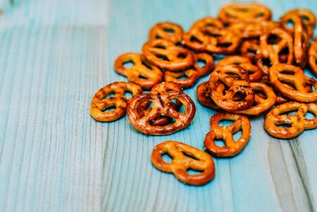 Food snack Salted crispy Pretzel on blue background with copy space
