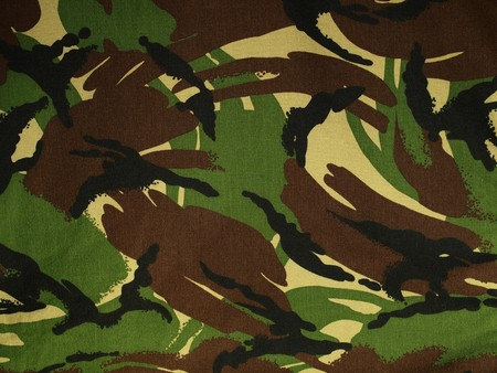 A section of camouflage fabric. Stock Photo