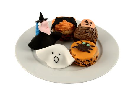 A plate of home made halloween iced cakes and marzipan fancies Stock Photo