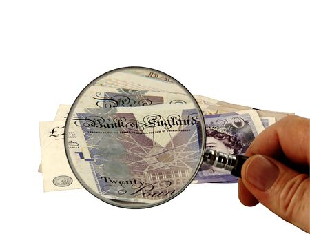 scrutinise: Currency being closely examined Stock Photo