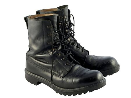 british army: A pair of worn black british army issue combat boots Stock Photo