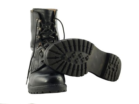 Two black military combat boots photo