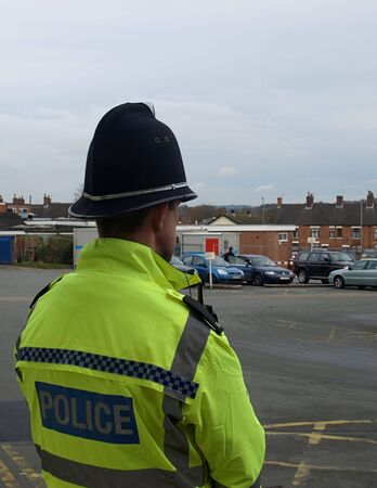 A UK police officer heeping a lookout whilst on the beat