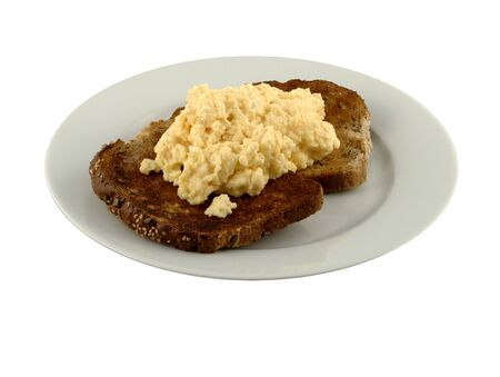 Scrambled egg on two slices of brown, seeded, toasted bread