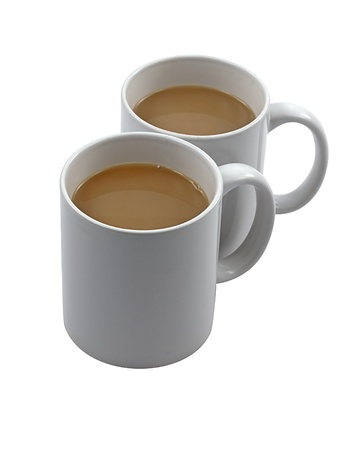 Two white china mugs of tea isolated