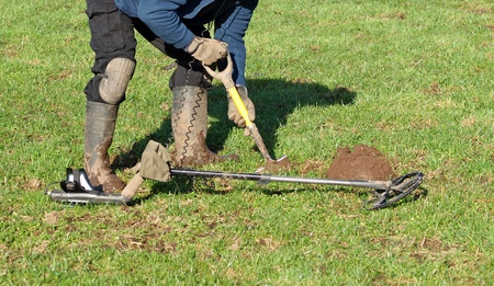 detecting: Digging a hole to retrieve signal metal detecting