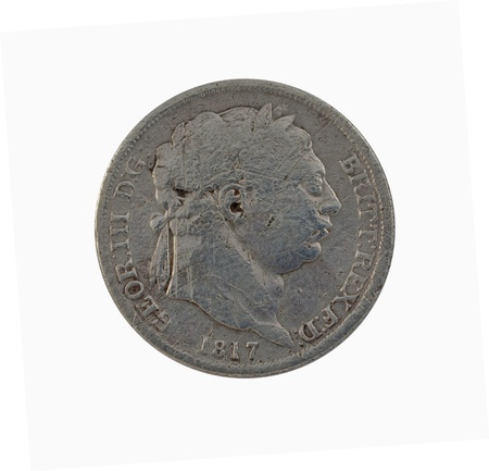 detecting: Silver George III sixpence of 1817, 19mm diameter, isolated on white