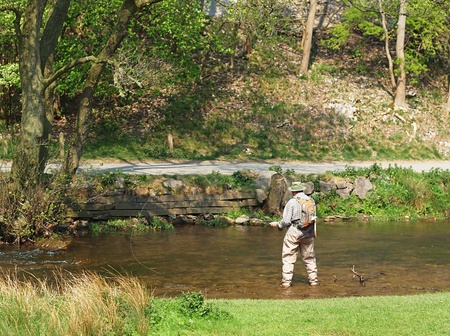 derbyshire: Fly fishing, River Dove, Dovedale on the Staffordshire Derbyshire border Stock Photo