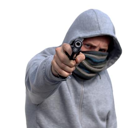 Jugend mit hoody zeigenden Pistole, isoliert auf weiss Lizenzfreie Bilder