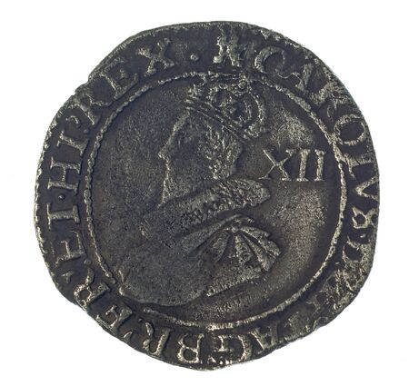 detecting: hammered silver shilling of Charles I Stock Photo