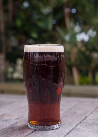 pint of english bitter on pub beer garden table