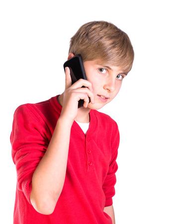 pre teen caucasian boy making call on mobile telephone