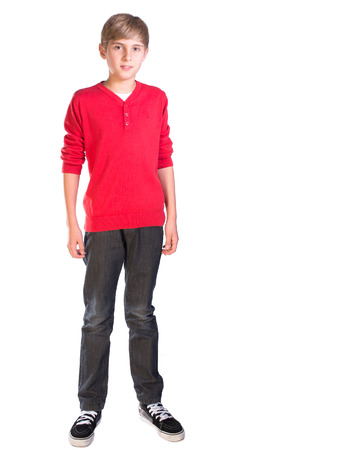 pre teen male caucasian boy against white background photo