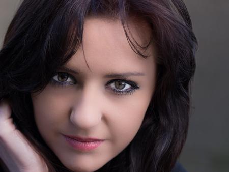 impassive: beautiful young woman with intense gaze