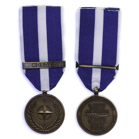 obverse: NATO peacekeeper medal obverse and reverse on white background Editorial