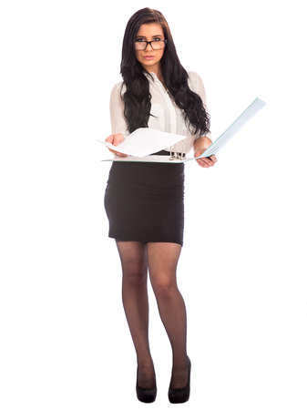 secretary skirt: attractive young business woman handing over report Stock Photo