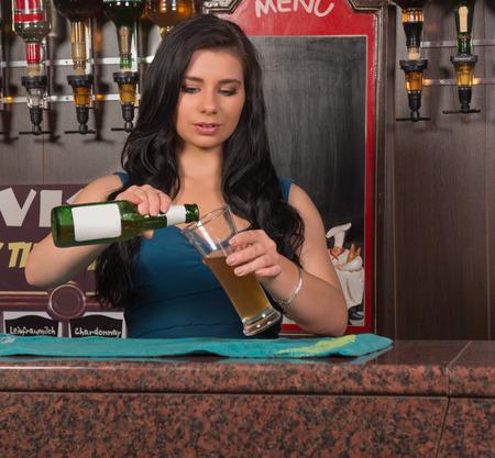 attractive young barmaid in pub