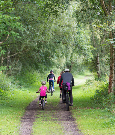 family cycling in the Consall Valley popular with tourists in Staffordshire Stock Photo