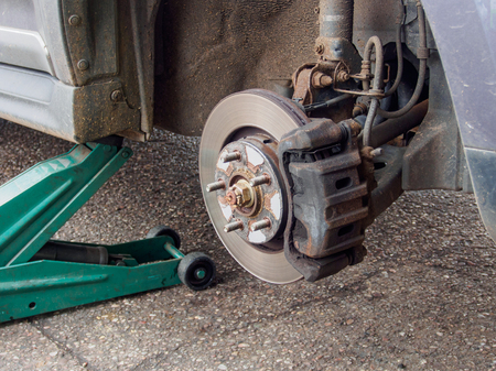 discs: car on jack with wheel removed showing brake discs