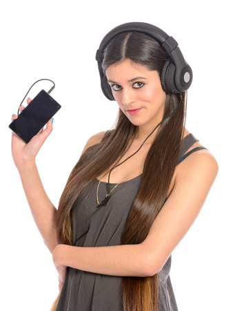 young woman with large headphones listening to music on mobile phone