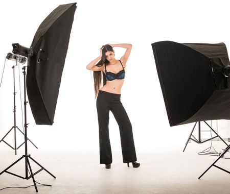 multi ethinic model posing in studio during photography shoot Stock Photo