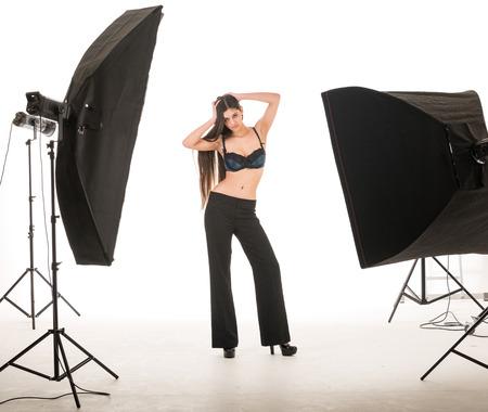 strobe lights: multi ethinic model posing in studio during photography shoot Stock Photo