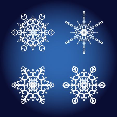 Set of four elegant vector snowflakes on a blue background, decorative design elements