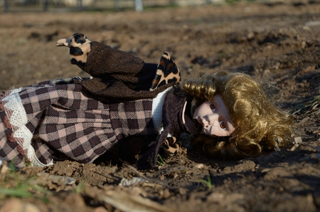 accident dead: Broken porcelain doll lying on the ground