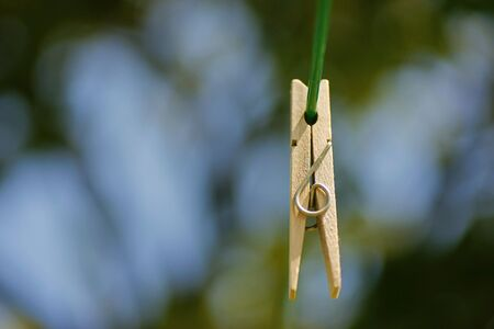 Clothespin on a wire Stock Photo