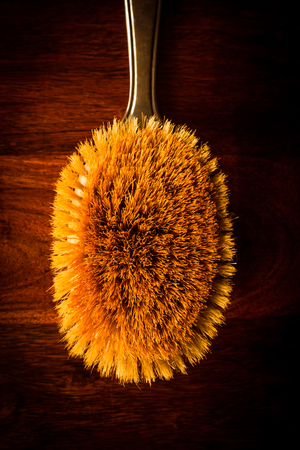 Vintage hairbrush on solid dark wood