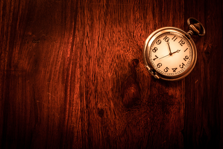 Vintage pocket watch on solid wood Stock Photo